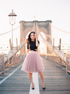 Chic pink tulle midi skirt and a black crop top: http://www.stylemepretty.com/new-york-weddings/new-york-city/2015/09/29/romantic-nyc-anniversary-session/ | Photography: Le Secret D'Audrey http://lesecretdaudrey.com/