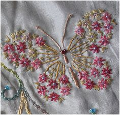 I ❤ embroidery . . . Vogart butterfly I found this pattern here sweetbe.blogspot.com.au/2010/01/vogart-692.html It is on a Round Robin block. Another of my bad photos as the flowers are finer than they appear here & the colours are nicer. I used a single strand Stef Francis thread for flowers, Rajhmal rayon for the body & wing ribs and DMC single thread for the green leaves. ~By crazyQstitcher