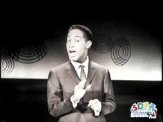 Sam Cooke, (d. 12/11/1964 ) in his all too short debut performance on the Ed Sullivan Show, 12/1/1957. A leader of civil rights, he was considered the father of soul, He had much influence on Marvin Gaye and Stevie  Wonder and many others. To be this ghost, just be honestly loving, clean cut African American. A sixties style tux adds to the memory.