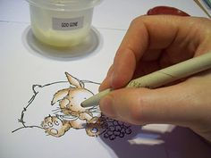Colored Pencil Tutorial using Baby Oil or Goo Gone to soften and blend colors. I have GOT to try this!