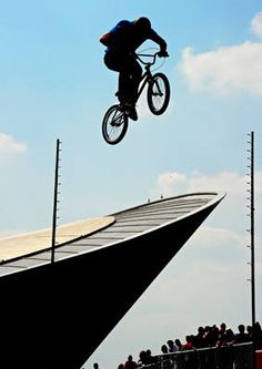 A freestyle BMX rider in the men's BMX quarterfinal heats