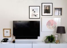I like how the gallery wall and TV work together