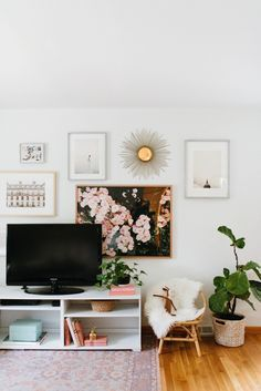 Caitlin Kruse's Living Room Makeover Midcentury modern inspired living room with a small gallery wall, a wicker chair, and a rug Room Makeover, Apartment Living Room Design, New Living Room, Living Room Wall, Small Room Design, Apartment Living Room, Living Decor, Living Room Makeover, Home Decor