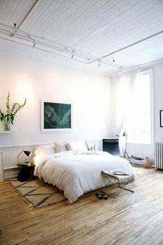 Bedroom with wood floors