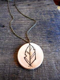 Geometric Feather Necklace  Wood-burned Feather Necklace   Wood Necklace  Nature Jewelry by IvyandBirdDesigns on Etsy https://www.etsy.com/listing/179729890/geometric-feather-necklacewood-burned