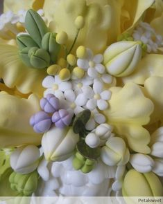 In addition to creating sugar flowers for our cake designs and classes, one of our favorite things to do at Petalsweet is to make flower bu...