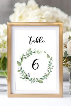 Greenery wedding table numbers, garden wedding ideas, green wreath table number from Pink Summer Designs on Etsy