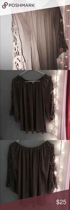 Light brown flow shirt. Size S/M Size S/M. Flowy, light brown shirt. Long sleeve, loose fit and very comfy. Lace on the side of the sleeves. Worn once to a special occasion, great condition. Tops Blouses