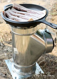 I love this camp stove!!!!! Great idea!!!~~DIY Camp Stove...We are thinking outside the box and made ourselves a camp stove out of ductwork!