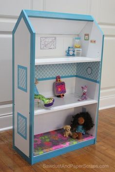 who has the money for expensive doll houses that the kids will tear up in a matter of minutes, this BOOKSHELF and a little paint make your own for less!