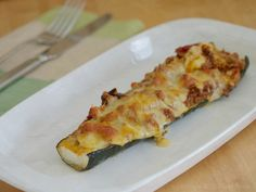 Baked zucchini stuffed with bacon, kransky and bolognese - yum!