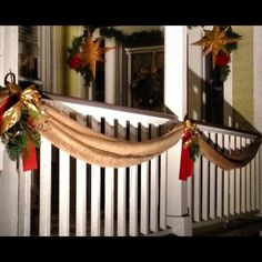 Great outdoor Christmas decor using draped burlap instead of garland. I could still wrap lights in the burlap.