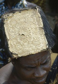 Africa | An Asante Nseniefo (herald/court crier) with the insignia of his office, a cap made of a wooden plate covered with gold leaf sewn onto the skin of a black colobus monkey. | © imknownmadic2 on Flickr