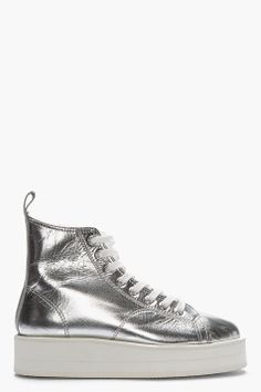 I spent a whole month in 2004 looking for these shoes. COMME DES GARÇONS Metallic Silver Leather Flatform Sneakers