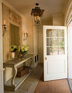 What a gorgeous foyer, warm and welcoming.  Try Benjamin Moore Face Powder http://www.myperfectcolor.com/en/color/379003_Benjamin-Moore-CSP-1085-face-powder    via Jane Schwab