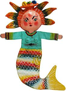 These colorful and fun coconut figures offer whimsical depictions of indigenous Mexican culture!  Each figure begins with a mask made from an emptied coconut shell and other dried plants. Then a cotton body is added and painted in the same high-quality, gloss paint as the head.  A hole to hang the figure is on the back. Also available as a separate mask, below.