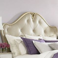 """Arched leather headboard with diamond button-tufting and scrolling filigree detail.   Product: Headboard    Construction Material: Wood frame and leather upholstery    Color: Pearl     Dimensions: Queen: 67"""" H x 69"""" W King: 69.75"""" H x 84.5"""" W                                        Note: Includes headboard only"""