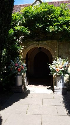 Entrance to church milk churns Florist in the Forest