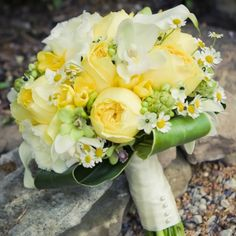 Bouquet- keep freesia, monte, white blown roses, size, shape. Switch to white asiatic lilies, bells of Ireland, yellow ranunculus.