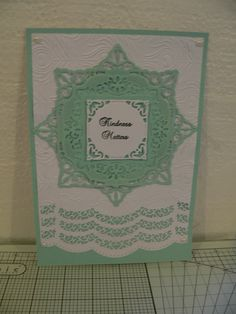 This one uses Spellbinders Adorning Squares and Spellbinders Scalloped borders 2