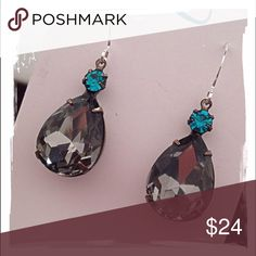 Swarovski Crystal Earrings - Handmade!! Faceted pear, charcoal Swarovski crystals accented with blue zircon Swarovski crystals. These are set in antiqued brass prong backings and hang from silver earwires. Jewelry Earrings