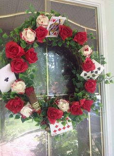Rose wreath at an Alice in Wonderland tea party luncheon! See more party ideas… Alice In Wonderland Garden, Alice In Wonderland Tea Party Birthday, Alice Tea Party, Alice In Wonderland Party Ideas, Winter Wonderland, Mad Hatter Party, Mad Hatter Tea, Mad Hatters, Painting The Roses Red