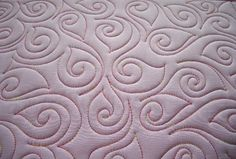 I've used this on a border, I like this free form.  Sew-n-Sew Quilting: Starting with a Swirl