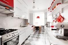 white kitchen, red accents, checkerboard floor