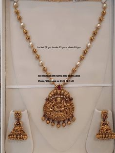 Sri Mahalaxmi Gems and Jewellers assure you for the finest finishing. exclusive designs and most reasonable prices. Presenting a very Lakshmi devi Locket set with pure south sea pearls chain and Jumke. Visit for full variety. Contact no 8125 782 Gold Chain Design, Gold Jewellery Design, Pearl Necklace Designs, Pearl Jewelry, Gold Jewelry Simple, Sea Pearls, Gold Necklaces, Gold Bangles, June