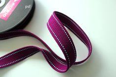 Raspberry webbing $8 by the yard on Etsy, also in other colors