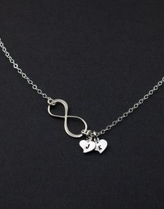 WANT! Infinity Necklace. Heart Silver Necklace. Personalized Jewelry. His and Her initials, friendship, family gift,Couple Infinity Love. $31.50, via Etsy.