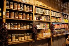 Casa Gispert...Go back in time. Breathe in the smell of toasted nuts, fired in the same wood oven since 1851. Marvel at the original counter and wooden shelves stacked with nuts and dried fruit of all descriptions.