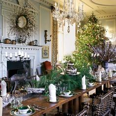 At Doddington Hall, a long dining table has been decked with foliage and sparkling silverware.