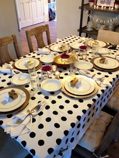 Kate Spade inspired tablescape for a dinner party, black, white and gold with a touch of purple.