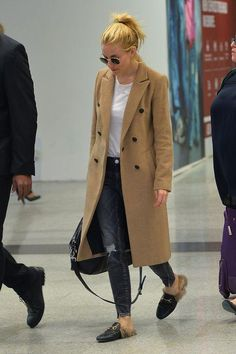 Pictures of celebrities at the airport: Come see what style stars like Sienna Miller wear when traveling (we love her double-breasted camel coat, jeans, and Gucci flats)