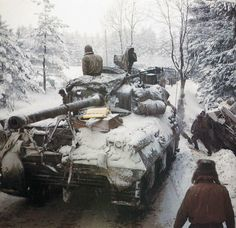 U.S. tanks moving cautiously through the Ardennes - December 1944  George Silk / LIFE