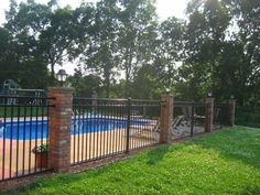 Wrought iron fence around a swimming pool. Image via s-media-cache-ak0.pinimg.com