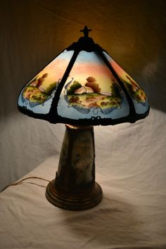 Antique reverse painted glass table lamp of a tropical for Forest chandelier ebay