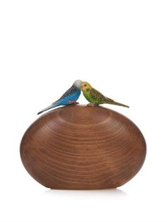 Sarah's Bag: A pair of budgies adorn this handmade wooden clutch from Sarah's Bag. The smooth, oval shape shows off the natural wood grain, and it comes with an optional gold-tone metal chain strap so you can go hands-free.