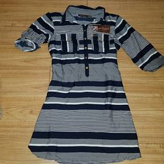 Boutique brand shirt dress Navy and white striped shirt dress.  Comes with fabric belt.  Never been worn. Tag says large but IMO would be a Medium  100% Polyester - it has a silky feel. Speed Control Dresses Long Sleeve