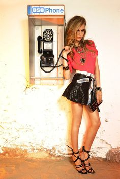 Alluring beauty Cara Delevingne in designer leahr skirt.