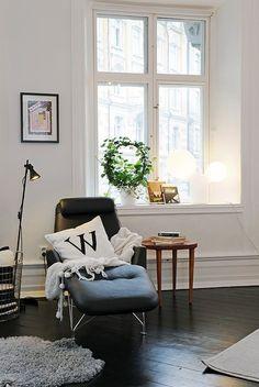 reading corner white wall as dark floors