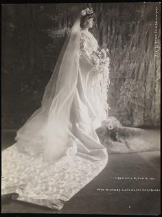 """Gelatin Silver Print, Alice Roosevelt Longworth (1884-1980) in her Wedding Dress, Photography by Byron Company (New York, New York): 1906, """"Alice Roosevelt Longworth standing in her wedding dress in a profile view to show off the train at the White House in Washington D.C. Her bouquet is visible and she stands in front of a curtain."""""""
