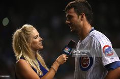 Kelly Crull of Comcast Sports interviews Kris Bryant #17 of the Chicago Cubs after he hit a walk-off, two-run home run against the Colorado Rockies at Wrigley Field on July 27, 2015 in Chicago, Illinois. The Cubs defeated the Rockies 9-8.