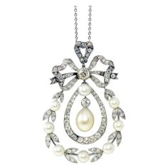 Edwardian Natural Pearl Diamond Pendant | From a unique collection of vintage pendant necklaces at https://www.1stdibs.com/jewelry/necklaces/pendant-necklaces/