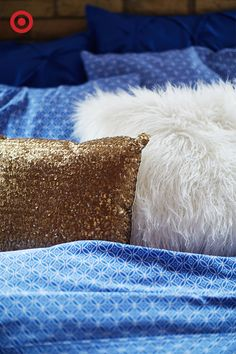 Extra details are what makes this bed the picture of relaxation: calming blue patterned sheets pair perfectly with a solid pinch pleat duvet, and the faux fur and sequin throw pillows add just the right amount of stylish warmth and texture.