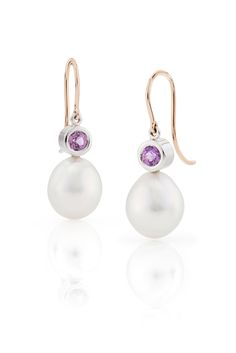 Earrings set with Unheated pink sapphires from Sri Lanka and South Sea pearls with a pink overtone from Australia From the Daniel Moesker Pearl Collection