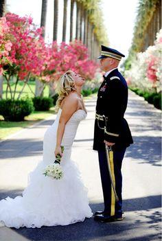 Groom in Marine Corps Blue Dress Uniform. Haha he can't move...