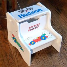 White Storage Step Stool with Race Cars is hand painted by Neat Stuff Gifts. Kids love the hidden space for all their little treasures!