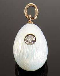 A Fabergé gold, enamel and jeweled miniature Easter egg pendant, workmaster August Holmstrom, St. Petersburg, c.1900, enameled translucent oyster and set with a diamond.